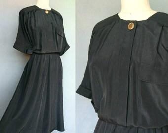 capricorn / 1980s black shirtwaist dress with gold button / 10 12 medium