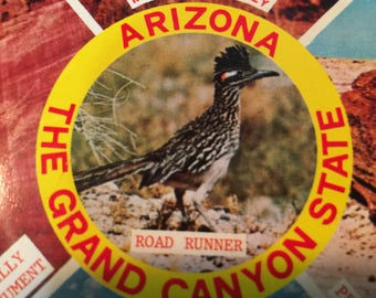 "Vintage 1980s Arizona ""the Grand Canyon State"" depicts a road runner, Canyon De Chelly, Petrified Forest Monument Valley, and Grand Canyon"
