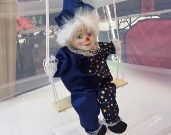Clown on a swing