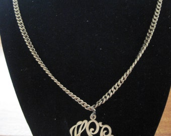 Gold vintage monogram necklace.