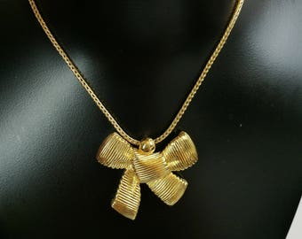 RESERVED!  Christian Dior vintage necklace with a gold tone bow pendant