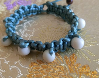 Weaved bracelets with silk string and beads