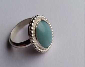 Silver ring with Amazonite of 18 x 13 mm with pearl wire ornamental rim size 19