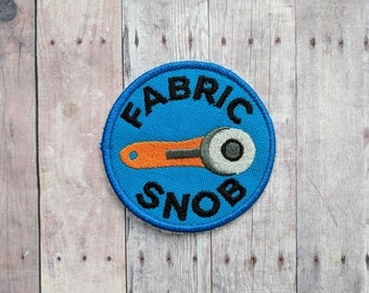 Fabric Snob Patch, Crafty Merit Badge, Embroidered Blue Canvas with Rotary Cutter & Black Text, Choice of Finding, Made in USA, Sewing Gift