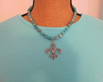 "Fleur de Lis Blue Rhinestone Pendant on Necklace of Blue Jasper Cubes and Seed Beads 17"""