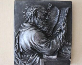 "Painting ""Saint Luke"" bas-relief from gypsum"