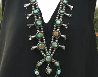 Squash blossom necklace. Royston turquoise, 194 grams. Circa 1980s. Sterling Silver. Navajo
