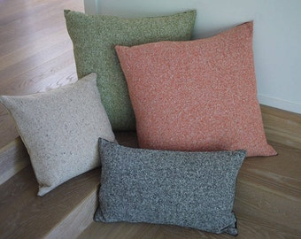 Wool tweed pillows with or without leather tassels. Made in Italy.