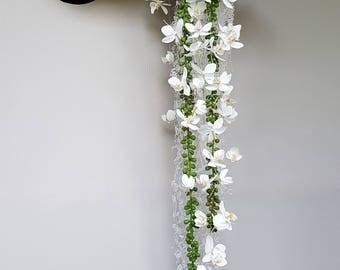 Bridal bouquet, bridal bracelet, permanent, cascading, made of glue lace and white orchids, bride's bouquet