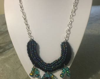 Handmade Beaded Horseshoe Necklace with Black and Gold and Auroa Borealis Beads