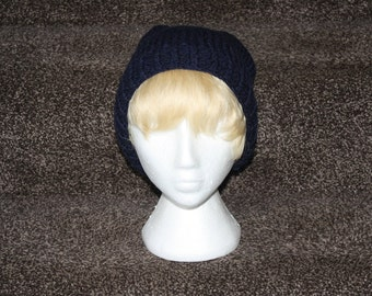 "A ""blueberry"" beanie, hand knitted."