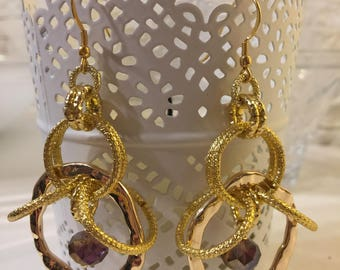 Gold chandelier earrings with purple Crystal
