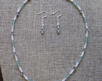 Lovely glass and metal necklace and earring set.  Aqua and white glass bead with daisy metal beads necklace and earring set