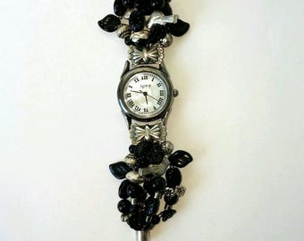 Retro Onyx Watch with Mother of Pearl face and silver bow attachments with beaded band.