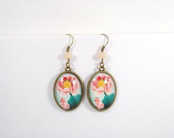 Earrings bronze metal, glass cabochons with pale pink lotus pattern.