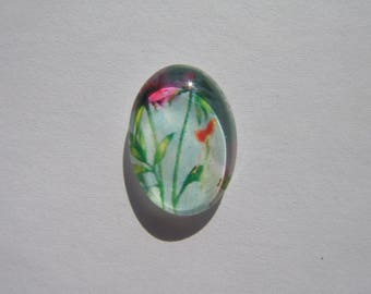 Glass cabochon oval 13 X 18 mm with a flower image colorful