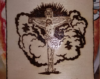 Wooden frame burning by hand. Crucifixion of Jesus Christ