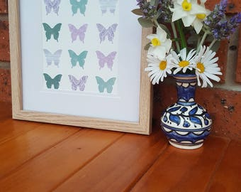 Mint green & purple butterflies on canvas