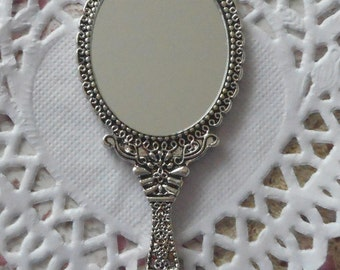 Charm mirror of 7,00 cm silver-plated finely crafted