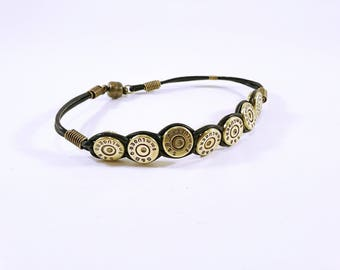 Cartridge casings and black leather cord bracelet