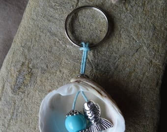 Door keys and/or blue bag with shell charm