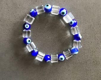 handmade beaded bracelet. hamsa, evil eye, plastic/resin/crystal