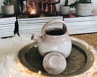 Pink glazed earthenware teapot