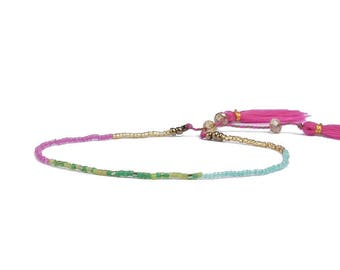 Purple bracelet with Japanese beads and tassels