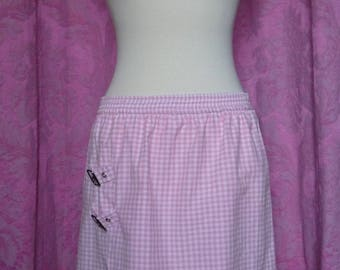 Pink gingham asymmetrical skirt with two metal buckles