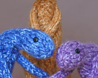 Knitted Baby Troodons in Knitted bag