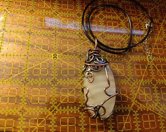 Transluscent white banded agate copper wire wrapped pendant necklace.