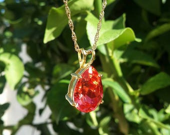 Gold filled necklace with Swarovski crystal in bright red color