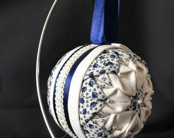 white and blue quilted ornament
