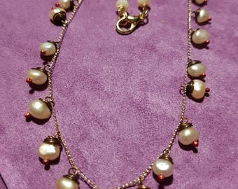 Pink pearl necklace and gold chain