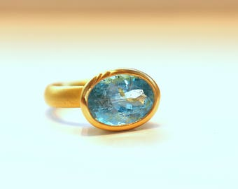 Ring of Gold 900 (22 carats) with aquamarine in strong blue