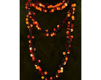 Red sequined necklace on black chain