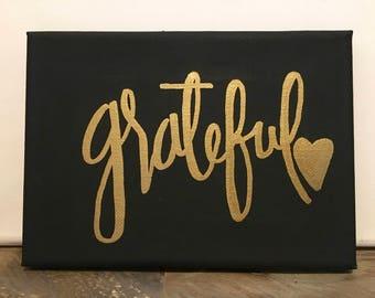 grateful: black canvas, gold lettering