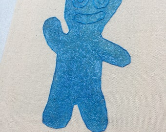 Blue Sour Patch Kid - hand drawn, painted and embroidered wall hanging