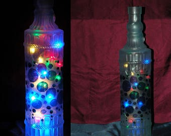 Handpainted Bottle Lights in choice of designs by FireHorse Designs. Price includes lights but not batteries.