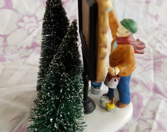 Department 56 Christmas Village Character Man Painting Sign, Porcelain, Two Bottle Brush Trees