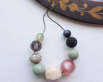 sagebrush - necklace - vintage remixed lucite - pastels soft colors watercolors - moonglow purple sage black beads
