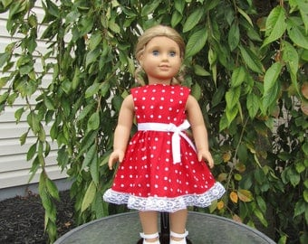 Cute polka-dot dress fits dolls like American Girl