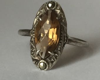 C. 1930s silver marquise shaped silver ring with marcasite and prong set yellow topaz glass stone - size 7 or N 1/2