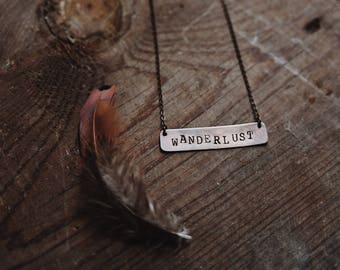 copper wanderlust necklace.