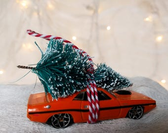 Orange Classic Car with Tree Strapped to the Top Ornament by Distinguished Flamingo