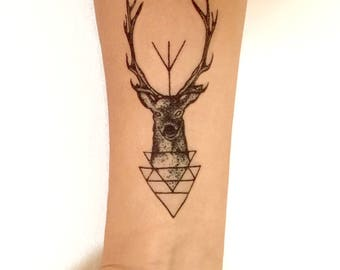 Temporary black ink tattoo of stag with triangles and trident. Temp tat, trial tat, ink, deer, antlers, body art, long lasting, accessories