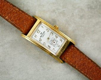 Vintage Waltham quartz watch with curved case and brown leather strap