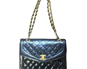 Vintage Chanel black lambskin rare double chain 2.55 shoulder bag with gold chain. Unique pentagon shaped flap.