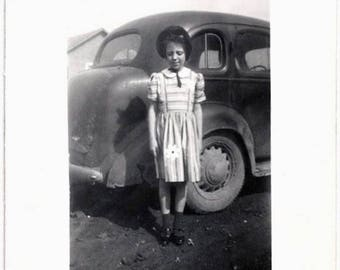 Old Photo Girl wearing Striped Fabric Dress with Applique Flower Standing by Car 1930s Photograph Snapshot vintage