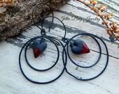 Black Widow- artisan red black ceramic hearts. black rings. annealed steel ring. rustic red heart earrings. Goth earrings.  Jettabugjewelry